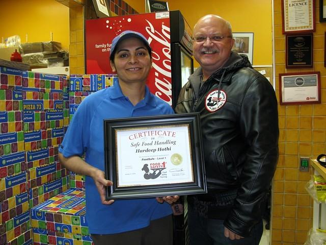 Food Safety 1st, Russell Scott presents Hardeep Hothi of Pizza 73 8th St, Saskatoon the 6,000th Food Safety 1st certificate!