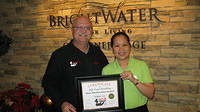 Food Safety 1st, Russell Scott presents Rose Marilou Delos Santos of Brightwater Sr Living the 8,000th Food Safety 1st certificate!
