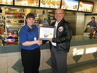 Food Safety 1st, Russell Scott presents Tracy Voth of McDonald's the 1000th Food Safety 1st Certificate!