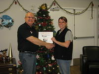 Food Safety 1st, Russell Scott presents Rhonda Gardiner of Cheshire Homes of Saskatoon the 7,000th Food Safety 1st certificate!