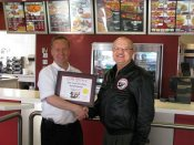 Russell Scott presents Keith Disney of El-Rancho Food Group, KFC the 2000th Food Safety 1st certificate.
