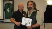 Russell Scott presents Douglas Terry of Melfort Sask. the 9,000th Food Safety 1st certificate.